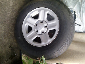 Set of 5 X Jeep tires(16x75x225)on rims,One tire is brand new