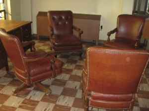 STATELY LEATHER CHAIRS, DEFINITELY NOT OFF THE SHELF.