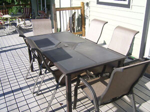 Large weatherproof table and 6 chairs and bench