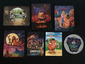 Collection of Disney Postcards and sticker.