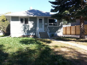 South Hill 2 bd suite with garage; utilities incl