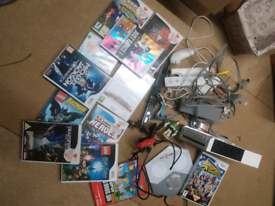 Nintendo Wii plus remotes and games