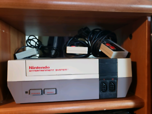 Nes game machine new pins in it and games