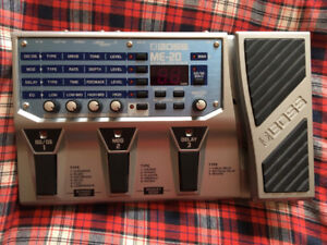 Boss ME-20 Guitar Multi-effects pedal with power supply.