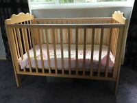 Wooden cot. Hardly used