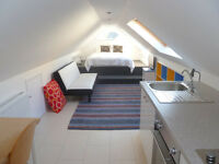 S/C Loft flat offered in Falmouth area for short holiday stays in exchange for gardening