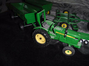 john deere toy tractors and wagons and some other stuff London Ontario image 1