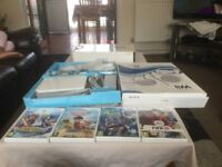 Wii with games and accessories and sports pack