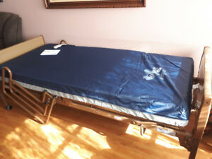 BRAND NEW - NEVER USED - INVACARE FULLY ELECTRIC HOMECARE BED