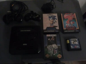 Sega genesis and 4 games and hard modded original x box