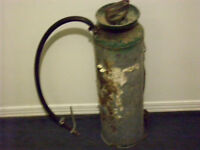 fire extinguisher or poison sprayer ( not sure)
