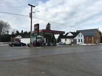Very busy gas bar/convenience store with land