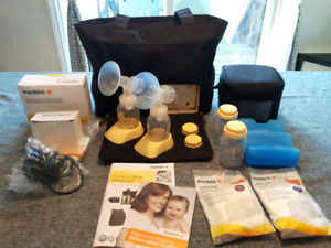 Tire-lait NEUF Medela double Pump in Style