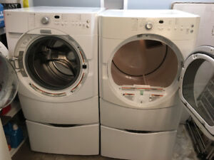 Front loading Maytag Washer/ dryer with pedestals