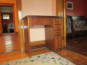 Singer Featherlite Sewing Machine in solid wood cabinet