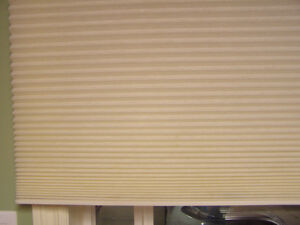 2 Top-down bottom-up cream cellular light-filtering blinds