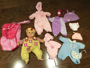 Baby doll with clothes and carrier $5
