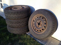 Mazda Protege winter tires and rims -- 185/65R14, set of 4
