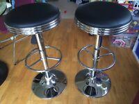 Pair of black and chrome retro bar stools