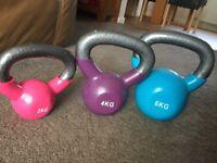 Three kettlebell weights 2-6kg.