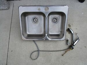 kitchen sink, faucet, soap dispenser and countertop