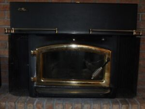 Elmira Stove Works Fireplace Insert with fan and chimney liner