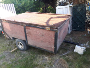 Small utility trailer with storage