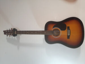 Lightly used Denver acoustic guitar