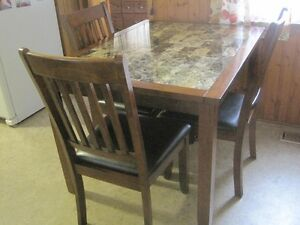 Dining table and 4 chairs, barely used