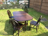 Double folding dining room table with four chairs