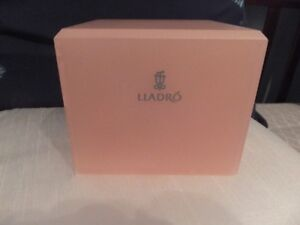 LLADRO STANDS WITH THEIR INSIGINIA IN IT FOR LLADRO FIGURINES