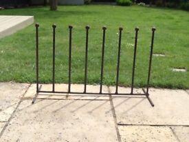 Antique black wrought iron boot rack