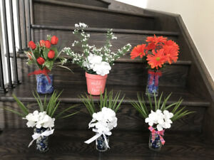 Artificial green plants / silk flowers with glass vases $5 to $6