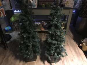 Two artifical pine trees.