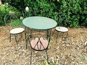 Wrought iron Patio table and chairs mid 20th century