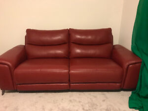 Red leather Power Recliner Month old from The Brick sat on twice