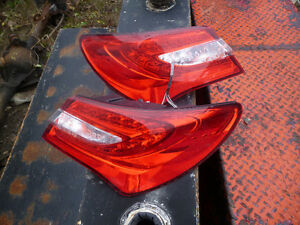 2012 Chrysler 200 sedan tail light lens with all lights inside London Ontario image 1