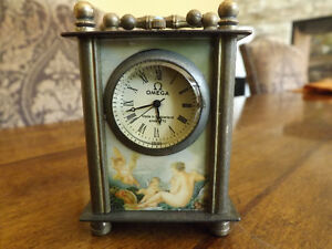 Vintage all copper hand-carved mechanical table clock OMEGA.