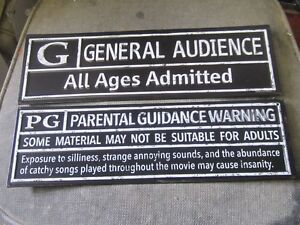 DECORATIVE PG & GENERAL AUDIENCE TIN SIGNS $20 EA. MOVIE DECOR