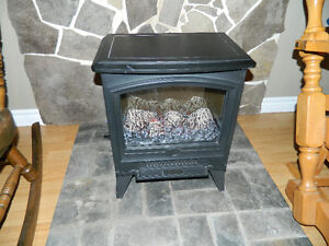 "Small fireplace/space heater (21.5"" tall x 17.5"")"