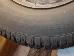 Winter tires on rims from a Ford half ton mint condition