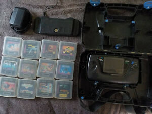 Sega Game Gear with 13 games carrying case rechargeable battery