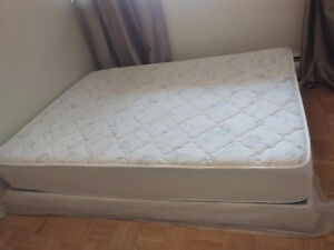 queen size bed with a new box and bunches of gifts