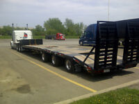 2015 Felling drop deck trailer with beaver tail.