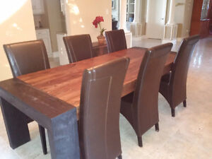 Solid exotic wood Dining room table with 6 leather chairs