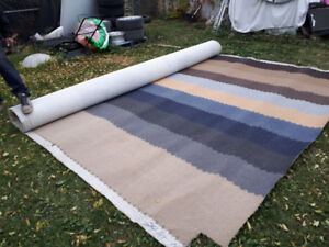 Carpet  new roll , multi colour , over 12ft wide by 26ft long.