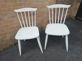 Two white wooden chairs