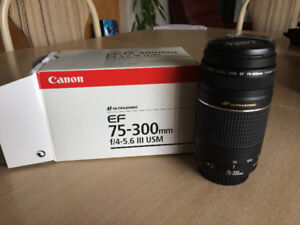 Canon telephoto lens for sale   (never used... as new in box)