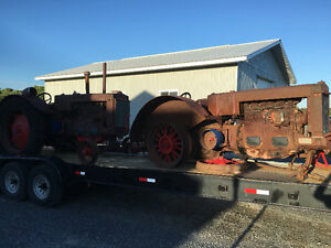 """Two old case tractors """"the old lady wants them out of the yard"""""""