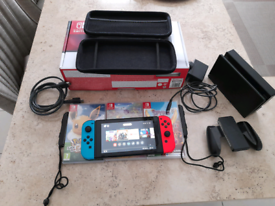 Nintendo switch with 3 games and carry case